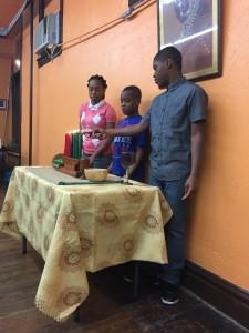 Lighting the Kwanzaa candles at the Karamu